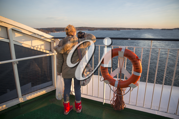 the deck of the ferry sailing to the sea.