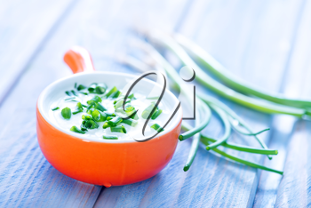 sour cream with green onion in the bowl