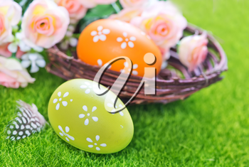 color easter eggs on a table, easter background