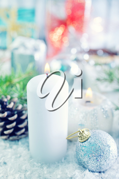 candle and christmas decoration on a table