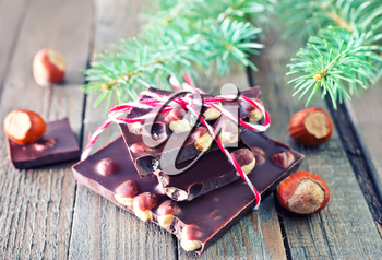 chocolate with nut and christmas tree on a table