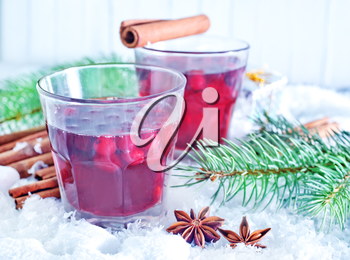 mulled wine in glass and on the white snow