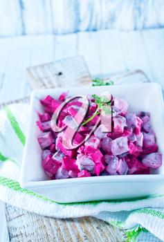 beet salad in bowl and on a table