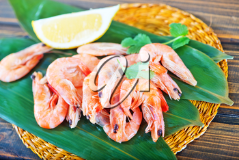 shrimps and lemon on the wooden table