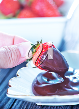 strawberry with chocolate on the plate