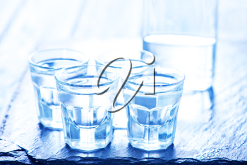 vodka into small glasses and on a table