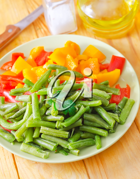 Fresh raw vegetables in the green plate