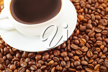 fresh coffee in the white cup, coffee and coffee beans