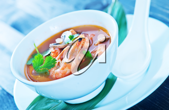 tom yam soup in the white bowl