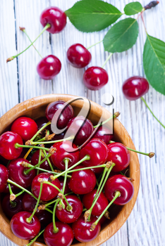 fresh cherry in bowl and on a table