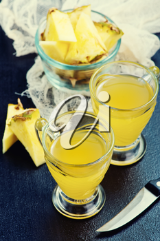 fresh juice and pineapple on a table