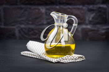 sunflower oil in glass bottle and on a table