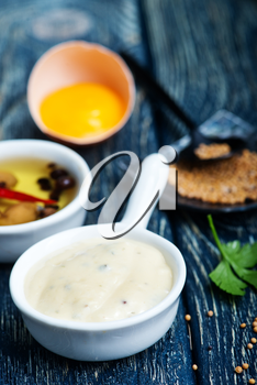 fresh mayonnaise sauce in bowl and on a table
