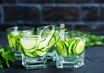 cucumber drink in glasses and on a table
