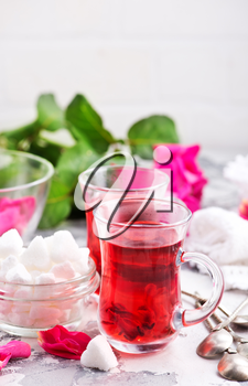 tea with rose on a table, stock photo