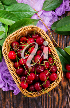 fresh cherry in basket and on a table