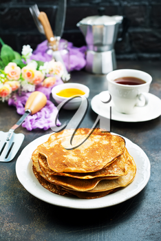 crepes with honey and fresh tea,stock photo