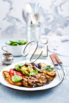 grilled vegetables with sauce on the plate, stock photo