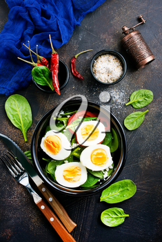 boiled eggs with vegetables in black bowl