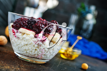chia desert with blackberry jam and nuts