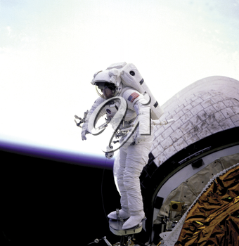 Royalty Free Photo of an Astronaut Standing on the Space Shuttle