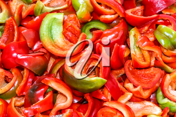 Background of the pieces of ripe chopped peppers