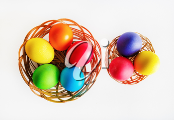 Colorful easter eggs. Two baskets with colored Easter eggs. Top view.