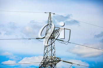 High voltage tower. Electricity pylon with blue sky background.