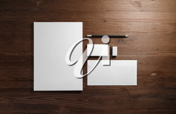 Photo of blank corporate stationery on wood table background. Branding mock-up. Flat lay.