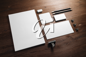 Blank corporate stationery for branding design. Corporate identity set on wooden background.