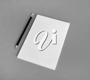 Blank notepad and pencil on gray paper background. Branding identity mock up.