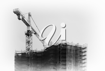 Black an white construction crane building city house background