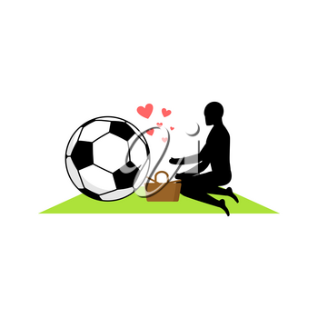 Lover Soccer. Guy and football ball on picnic. Meal in nature. blanket  and basket for food on lawn. Romantic date. Love sport play game