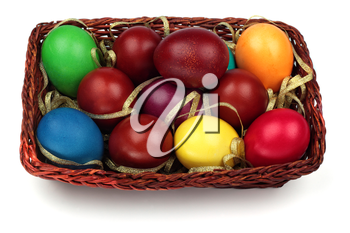 Basket with colorful easter eggs isolated on a white background