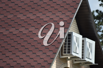 Decorative metal tile on a roof. Types of a roof of roofs.