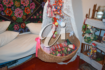 Cradle with dolls in the bedroom. Homemade great toys for children. Recreating the image of antiquity.