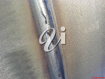 Welded seam on the pipeline. Compound of metal.