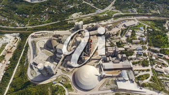 Verkhnebakansky cement plant, top view. Factory for the production and preparation of building cement. Cement industry.