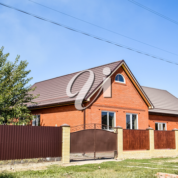 Detached house with a roof made of steel sheets. Roof metal sheets. Modern types of roofing materials.
