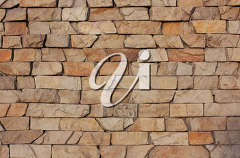 The old brick background. Medieval, antique textured wall fence. Stone in a row