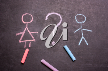 Figures of a man and a woman are drawn chalk on a blackboard. The concept of equality, feminism., gender,transgender