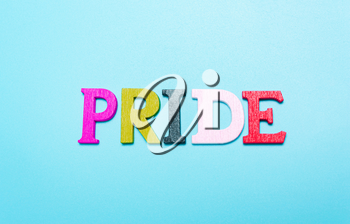 PRIDE word from rainbow color letters on a blue background