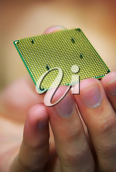 Processor in hand. Shallow depth-of-field.