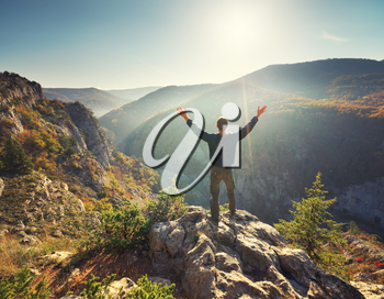 Man standing on the cliff. Conceptual scene. Mountain nature composition.