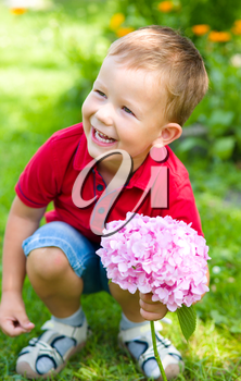 Little beautiful boy with flowers