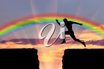 Jump runner athlete. Runner jumps over a precipice on the background of the rainbow
