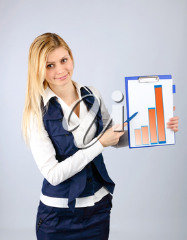Business concept. Business woman presents the company's revenue in the graph on the tablet