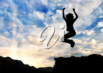 Concept of business success. Silhouette of a happy business woman jumping on top