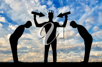 Silhouette of a selfish man with a crown on his head is trying to attract attention. The servants worship him. The concept of a selfish and narcissistic personality