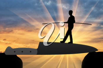 Silhouette of a man walking on a knife blade balances. Concept of risks and problems in business